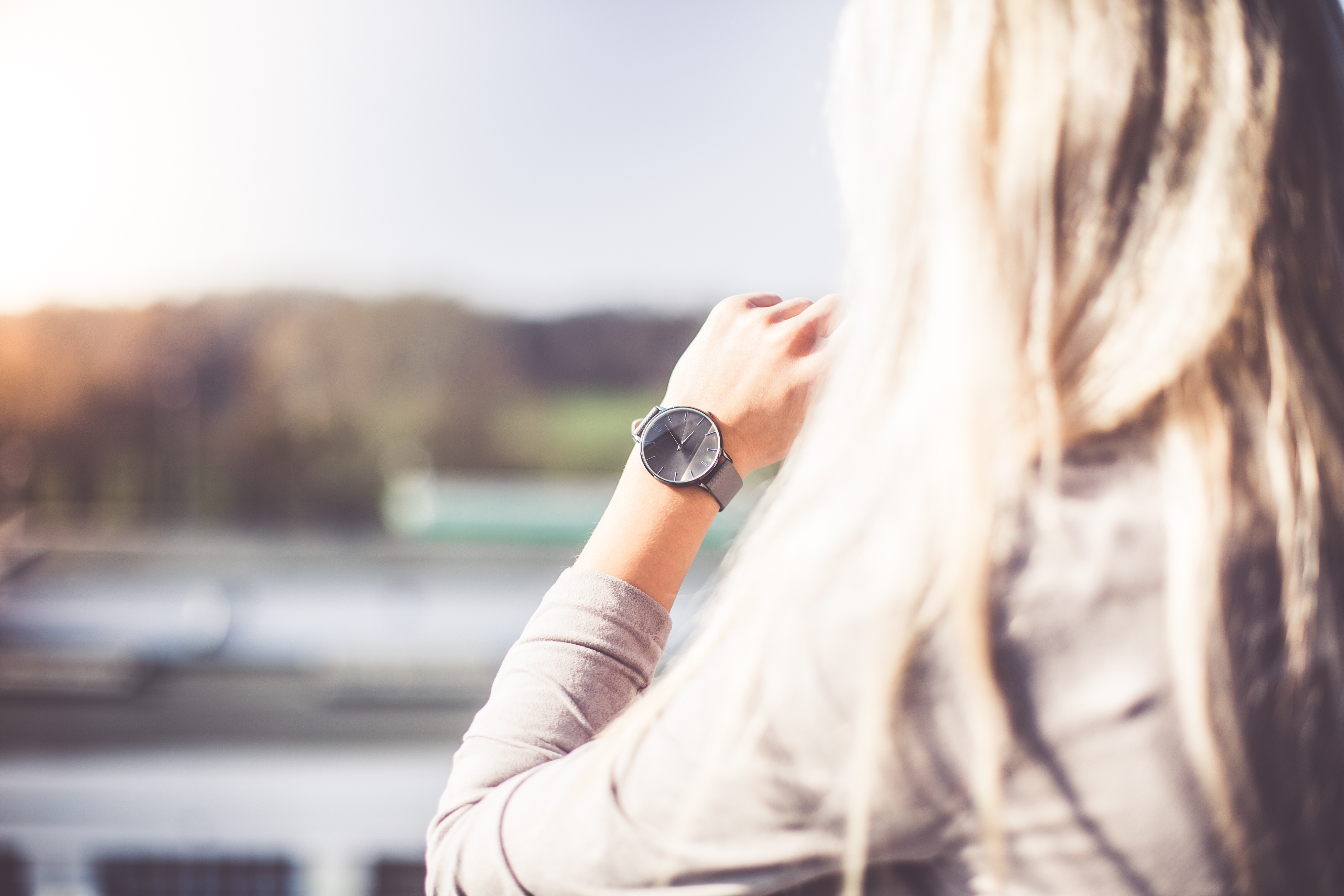 young-woman-with-gray-fashion-watches-enjoying-views-picjumbo-com
